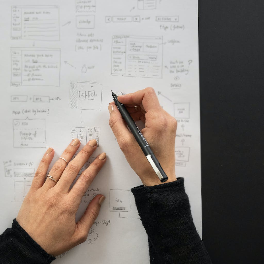 Photo of Myrian sketching wireframes on paper