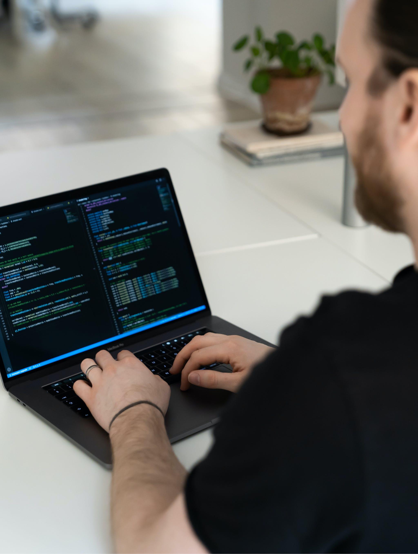 Photo of david coding on his laptop