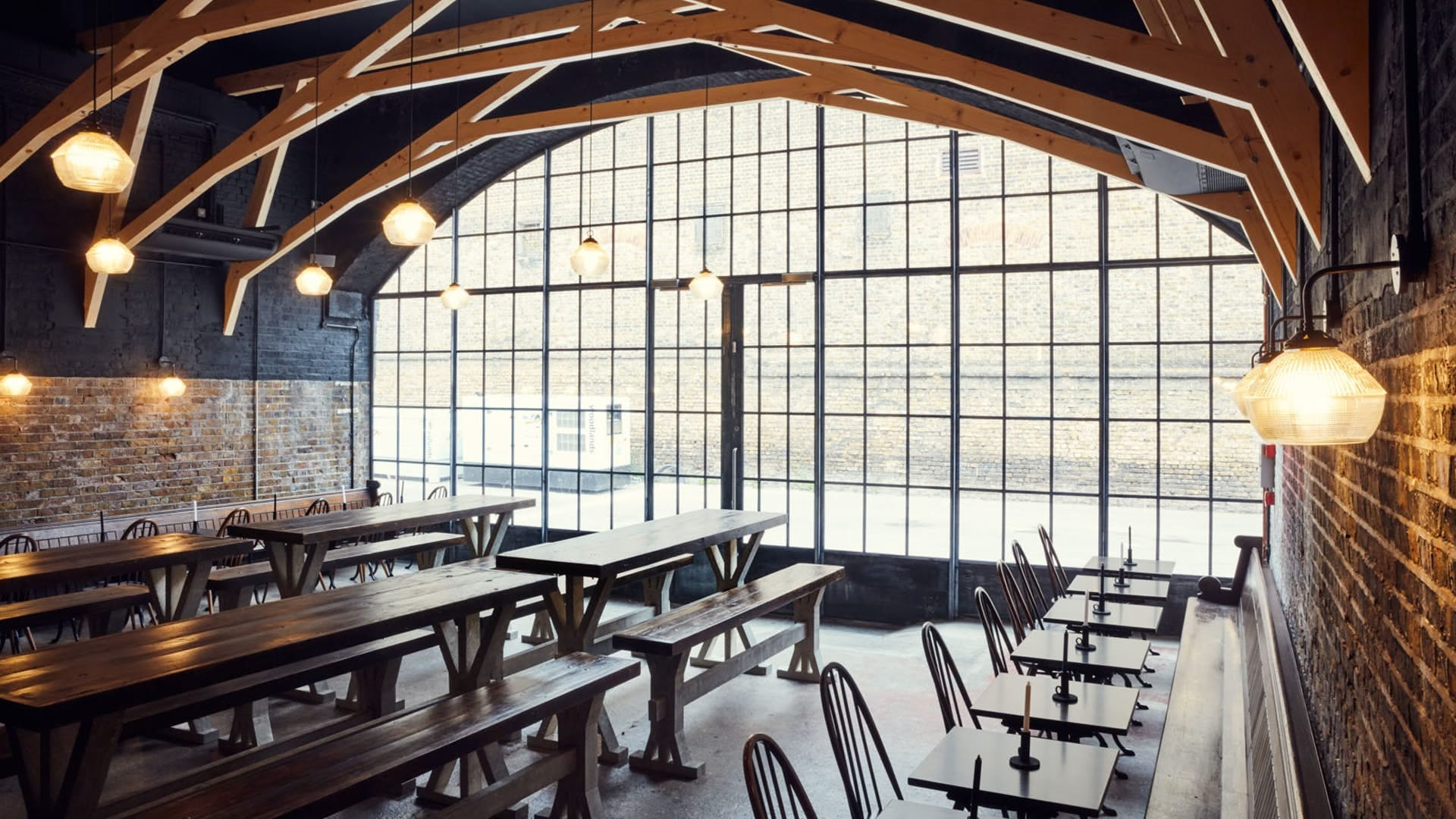 Vaulted room with benches at Hackney Church Brew Company