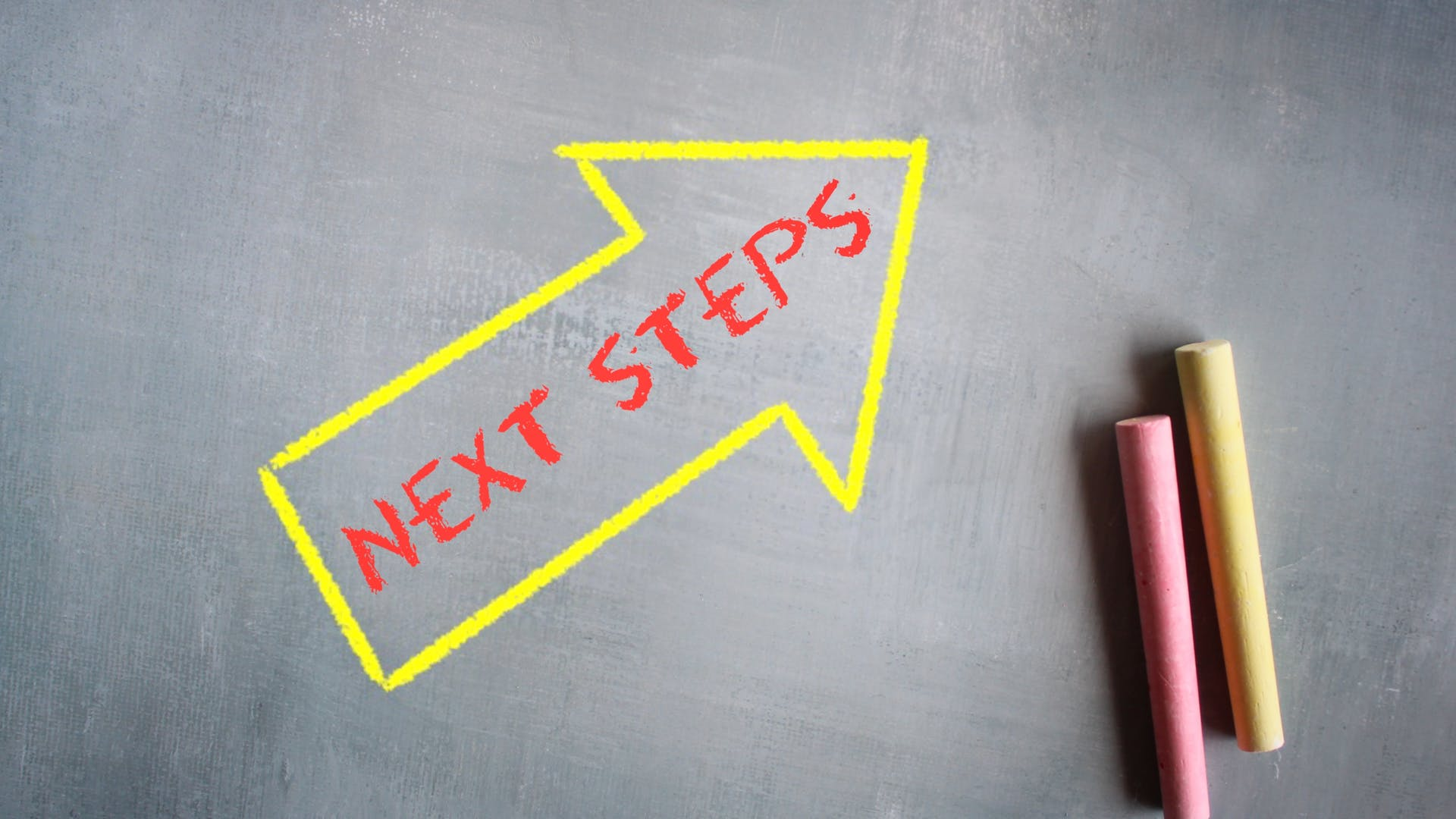 Next steps arrow sign and chalk board