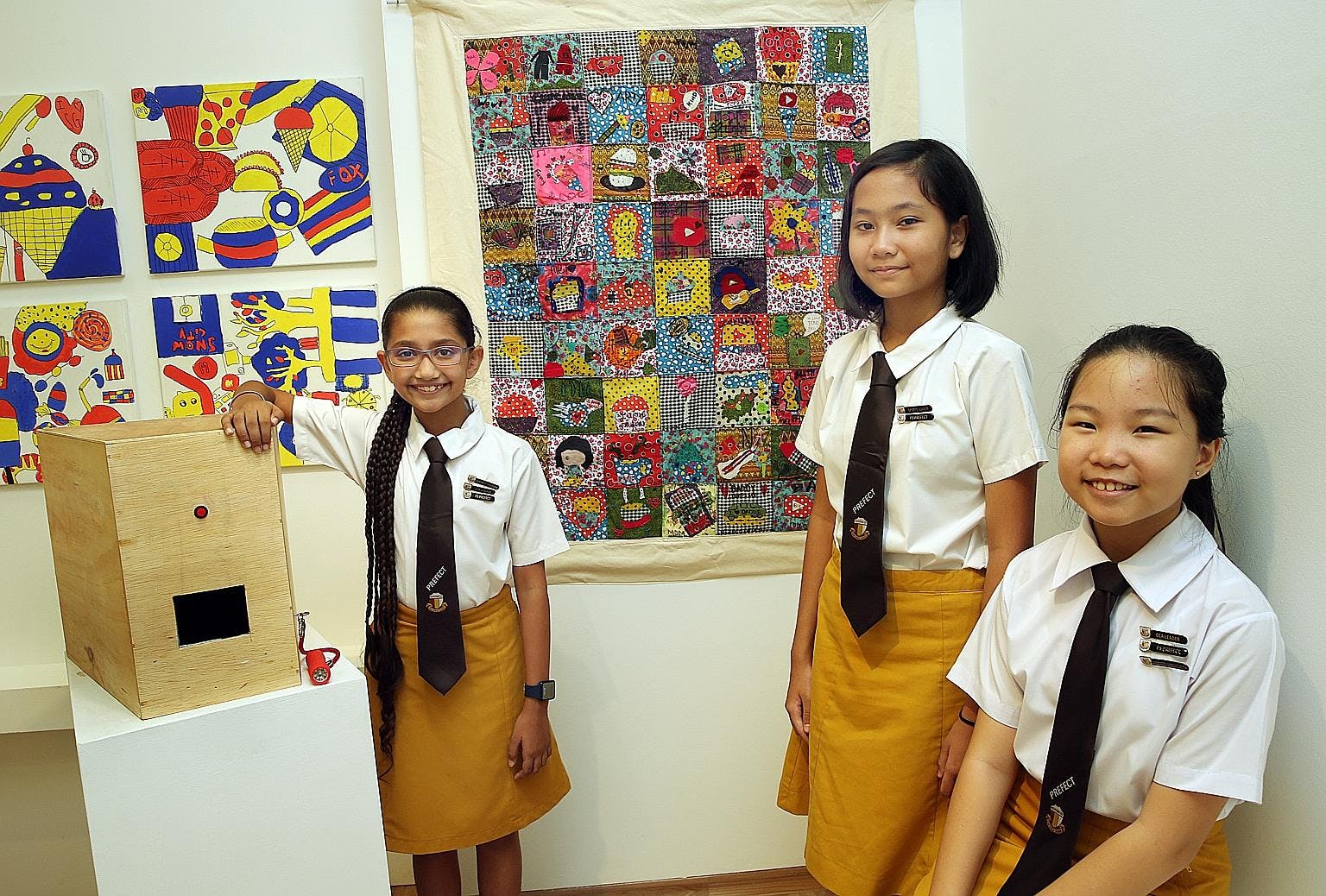 Students at Haig Girls' School posing beside a school project