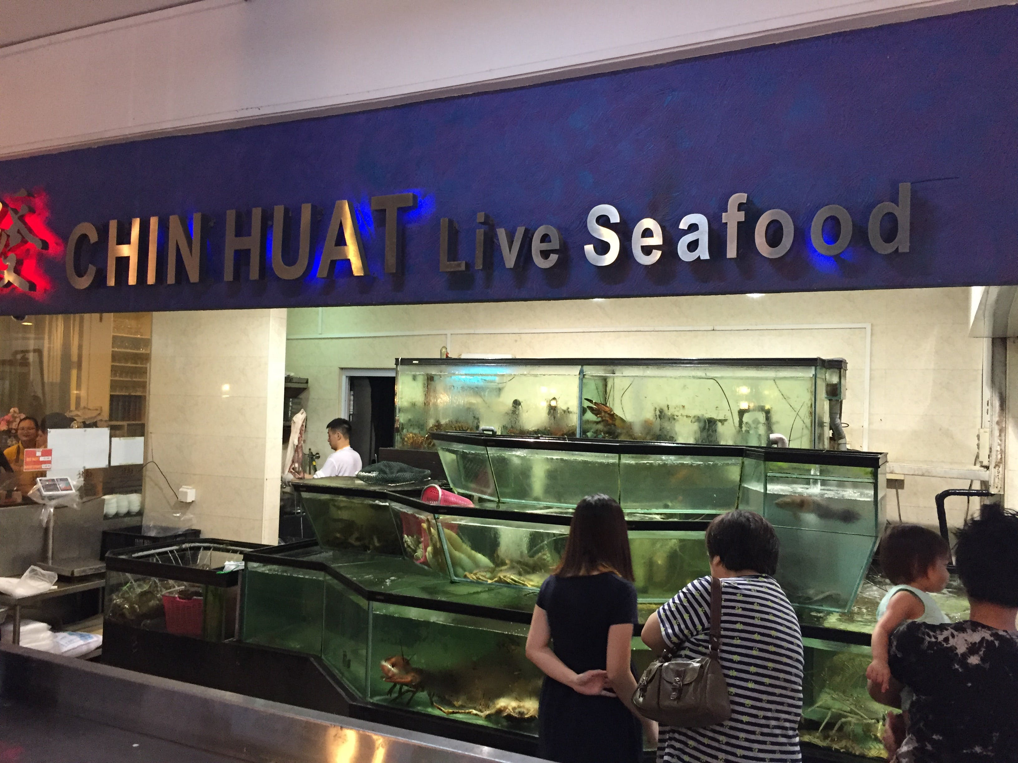Diners chosing their catch from the tanks at Chin Huat Live Seafood