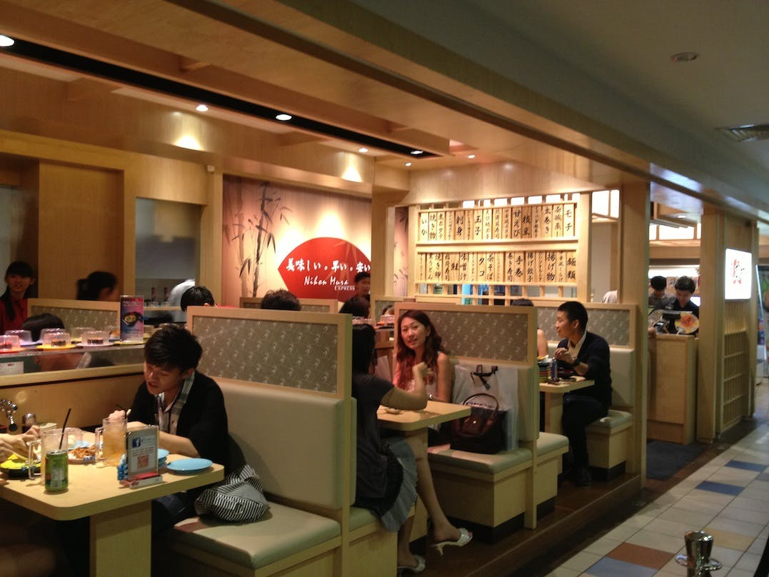 Diners enjoying their meals at Nihon Mura Express