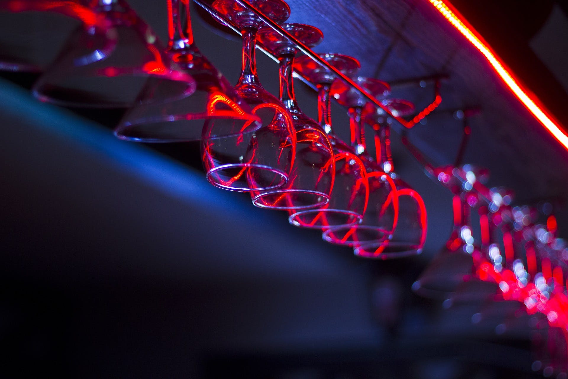 Wine glasses hanging overhead at a local bar