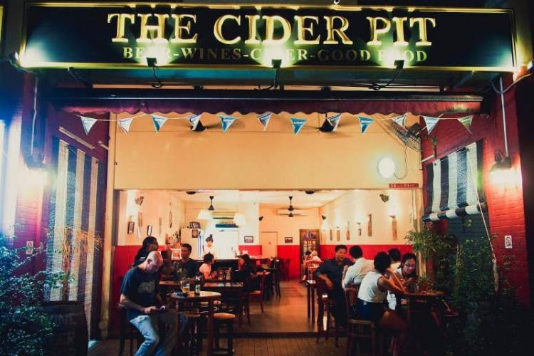 People lounge at The Cider Pit