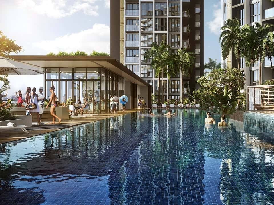 Lush greenery surrounds the luxurious pools at Park Place Residences.