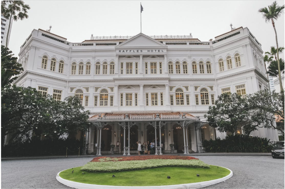 Raffles Hotel where you can enjoy a world famous Singapore Sling at the Long Bar