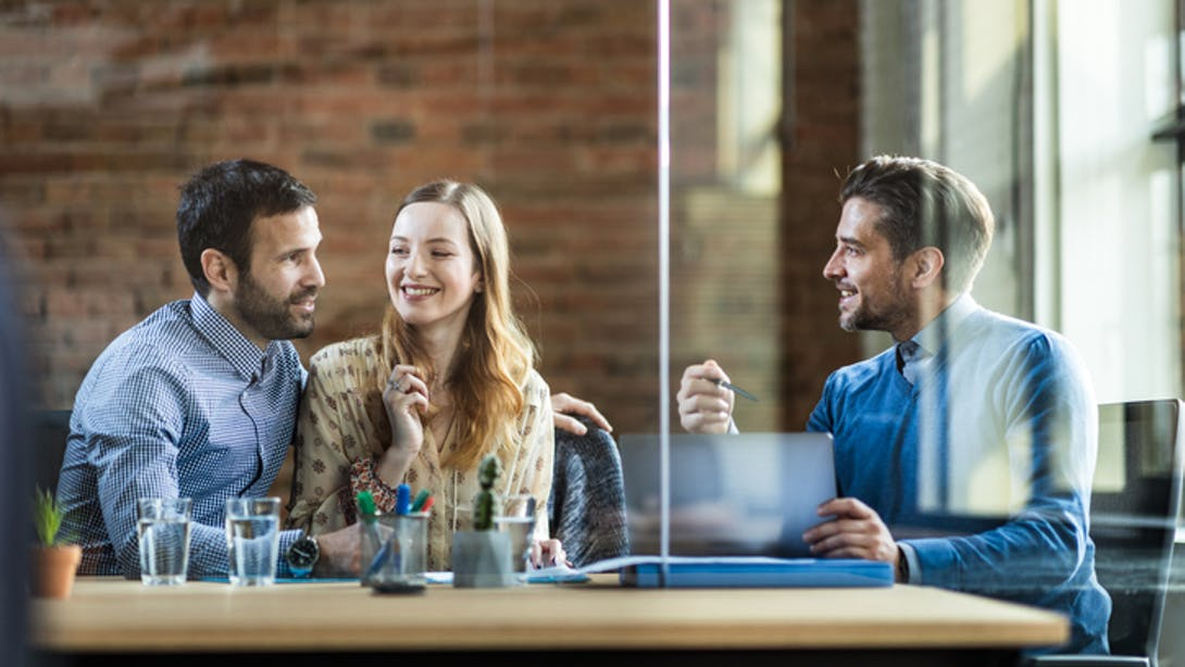 Three person in professional meeting