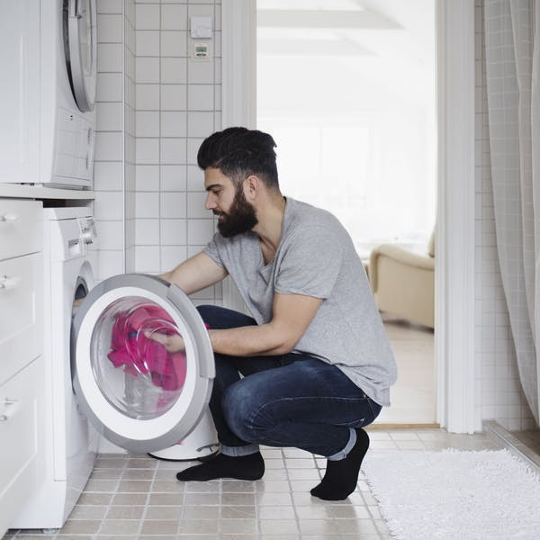 man in the laundry room