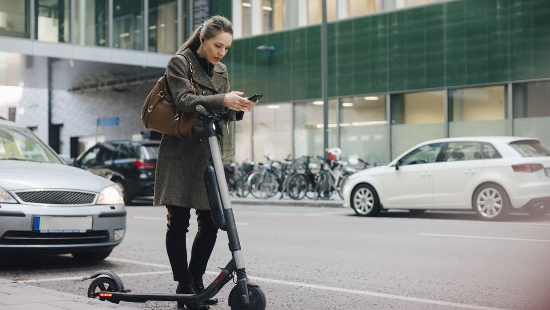 woman with her scooter