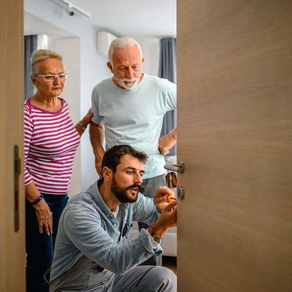 elderly couple with locksmith