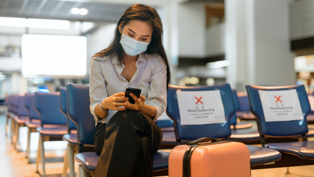 Woman with her phone and baggage