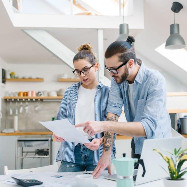 couple calculates their bills