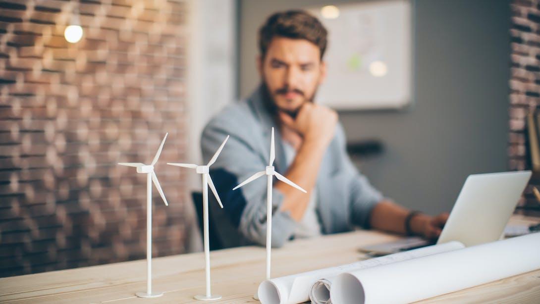 man with little wind turbine
