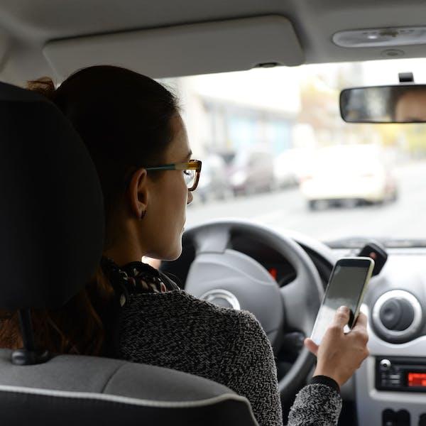 Aline in her car
