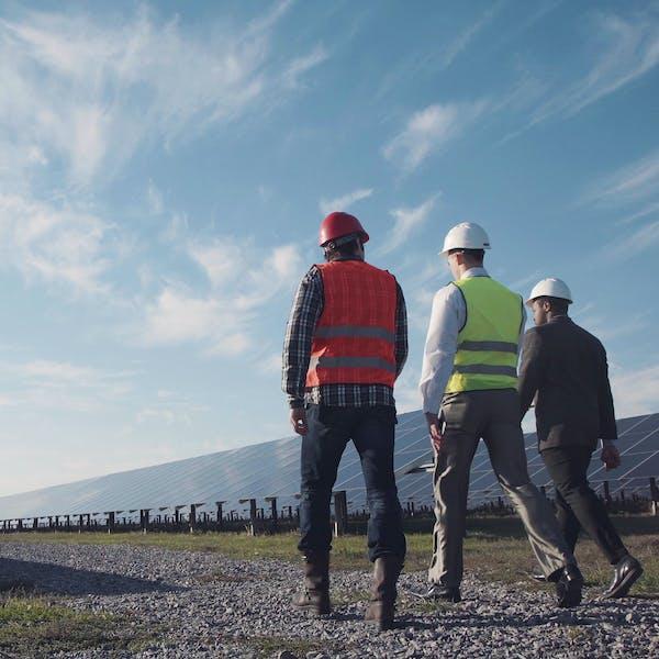 men in solar panel field