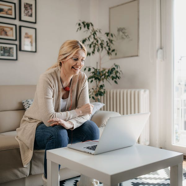 Woman in front of computer at home