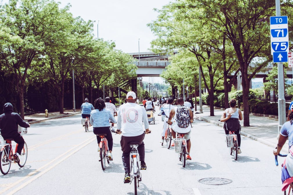 People cycling on the whole street