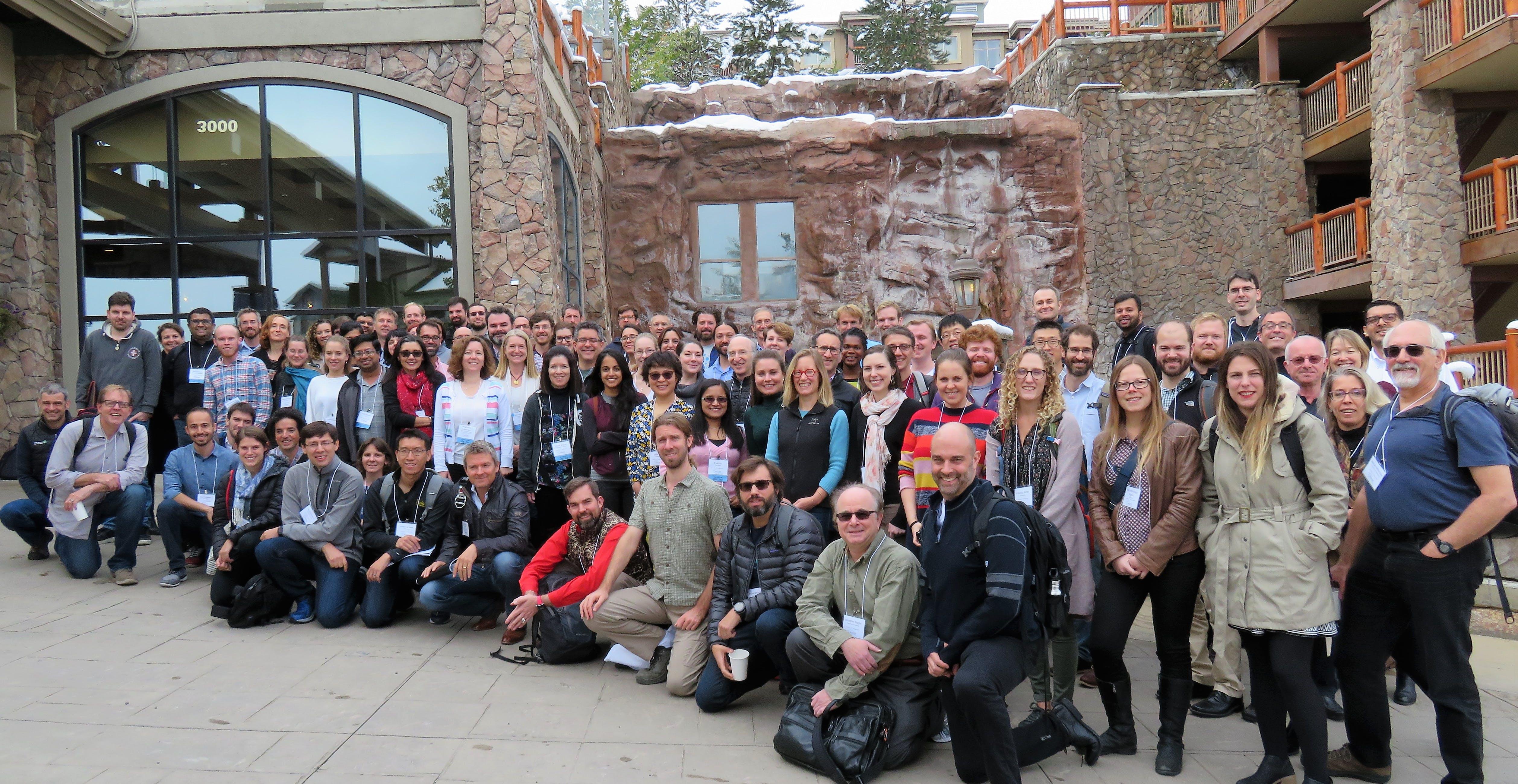 group photo outside a ski lodge