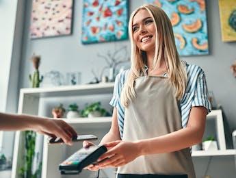 Retail worker offering customer service