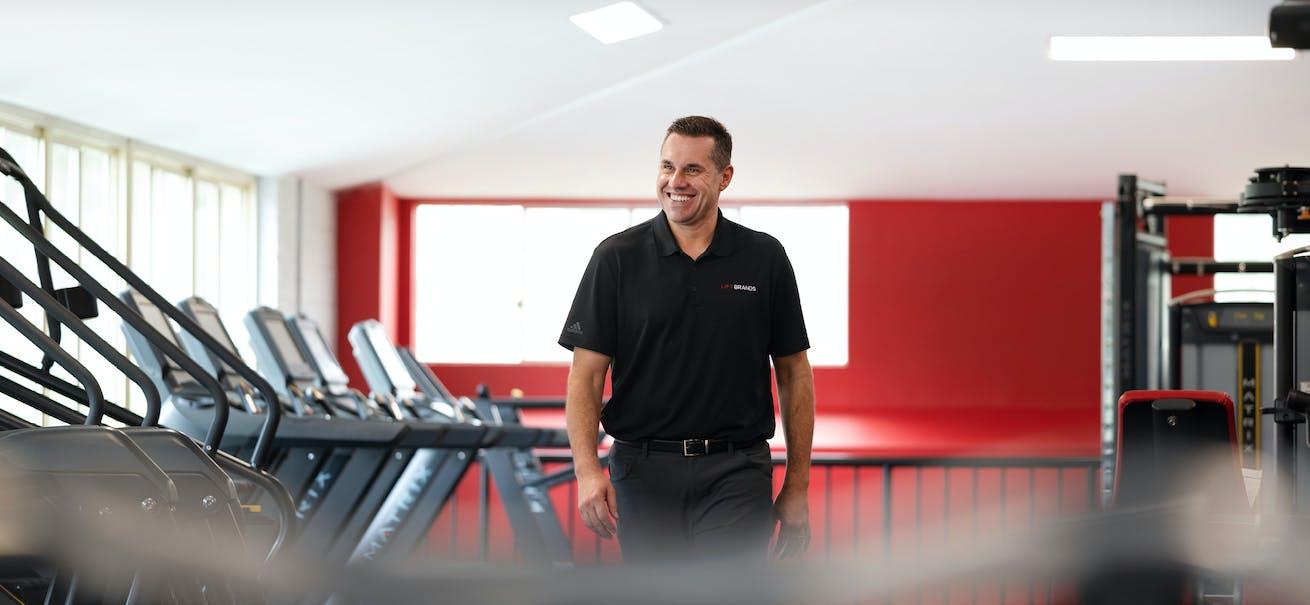 Chris Caldwell, CEO of SNAP Fitness among treadmills at Brisbane SNAP