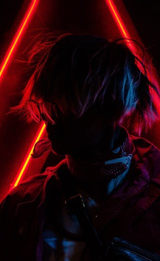 student with neon laser lights