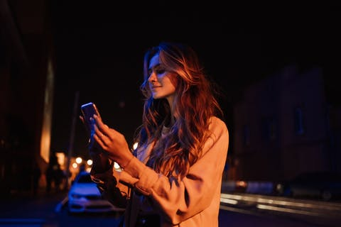 girl using phone at night