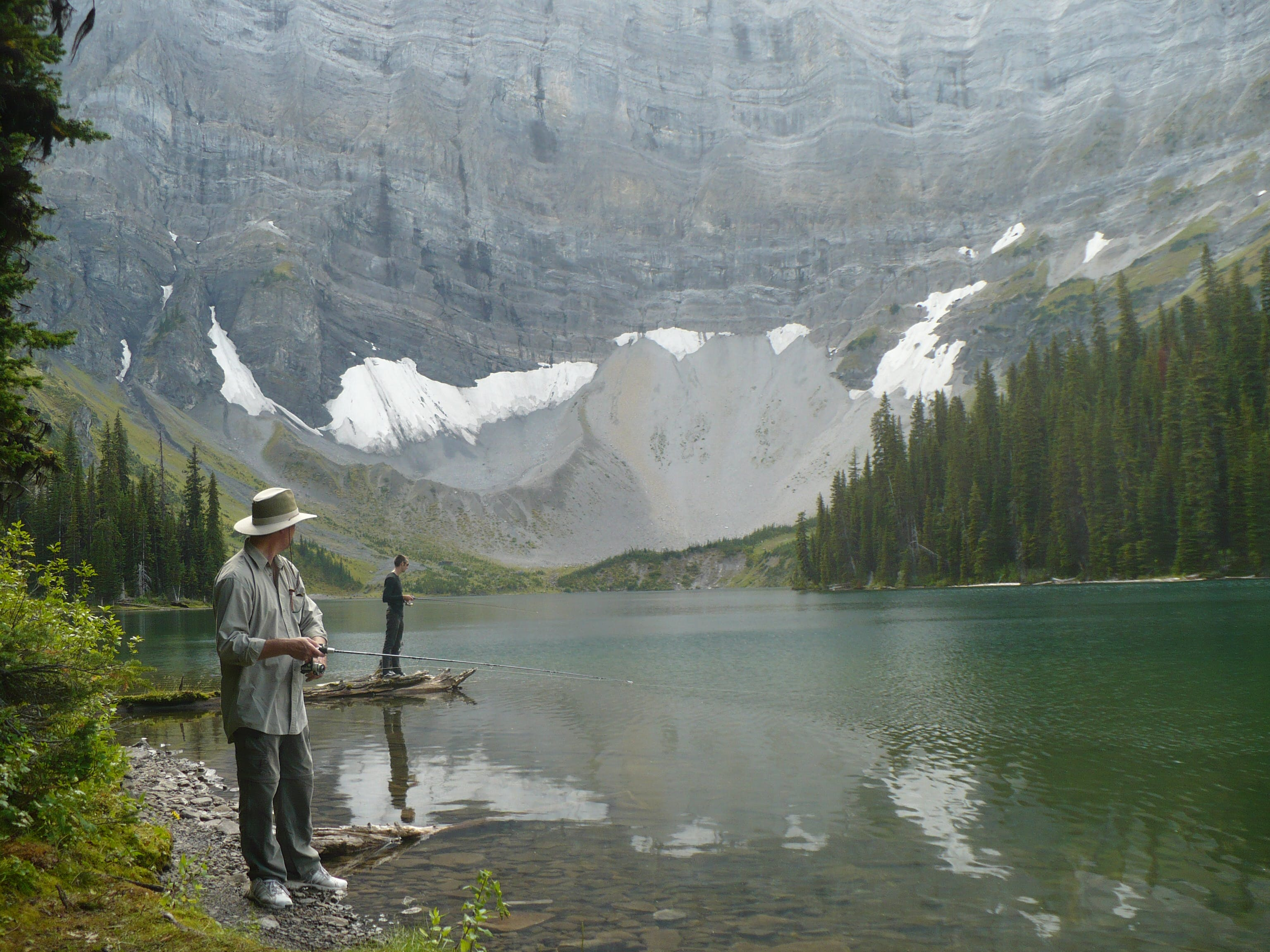 Father & son fishing an Alberta mountain lake