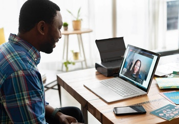 Man speaking on a video call with a woman