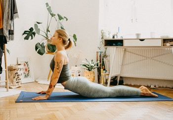 woman doing yoga with plants