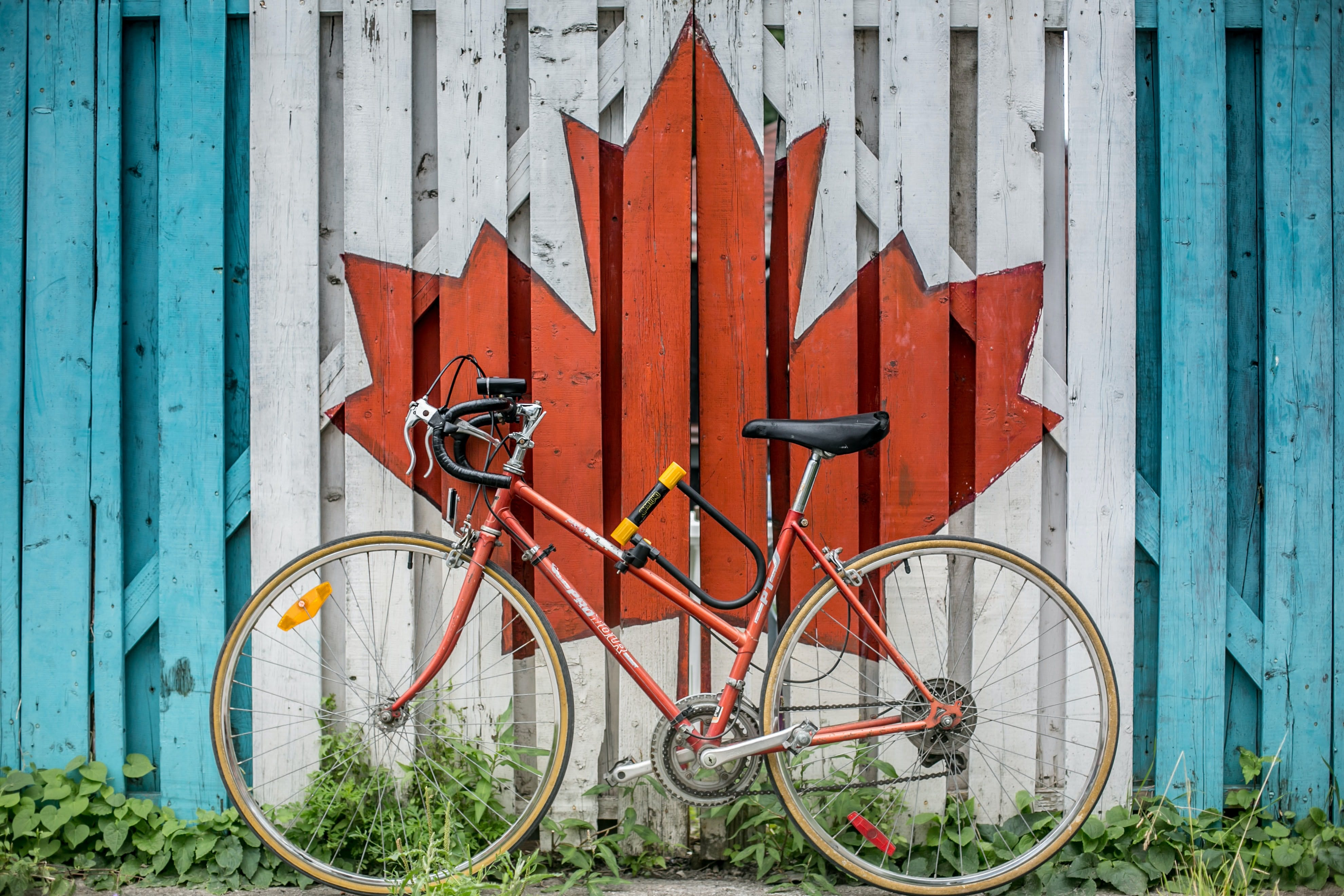 painted canada flag behind bicycle