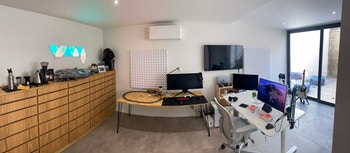 Home office with two desks and a cabinet