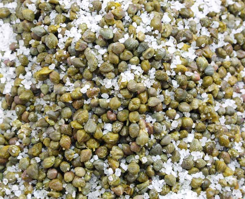 macro of capers with rock salt