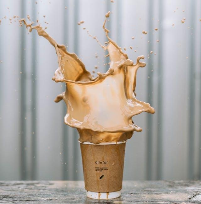 a splashing coffee cup