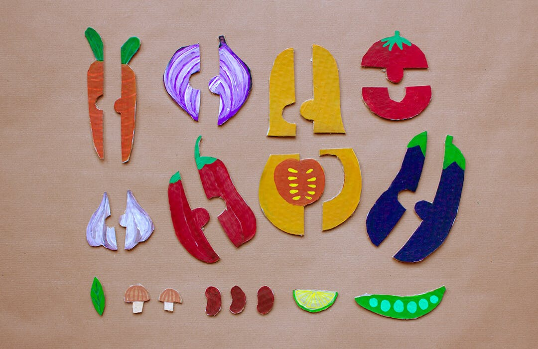 cardboard cutouts of vegetables in puzzle pieces
