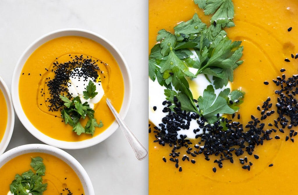 spiced carrot and butternut squash soup in white bowl
