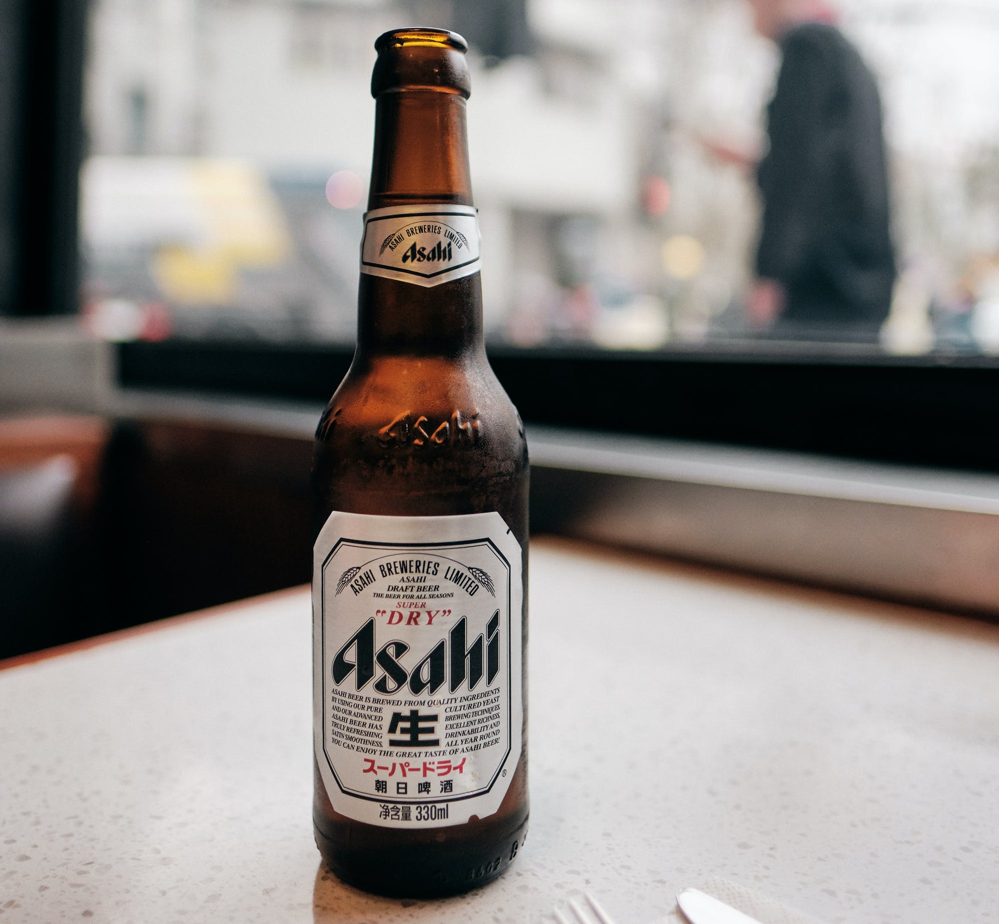 Bottle of Asahi Beer on table