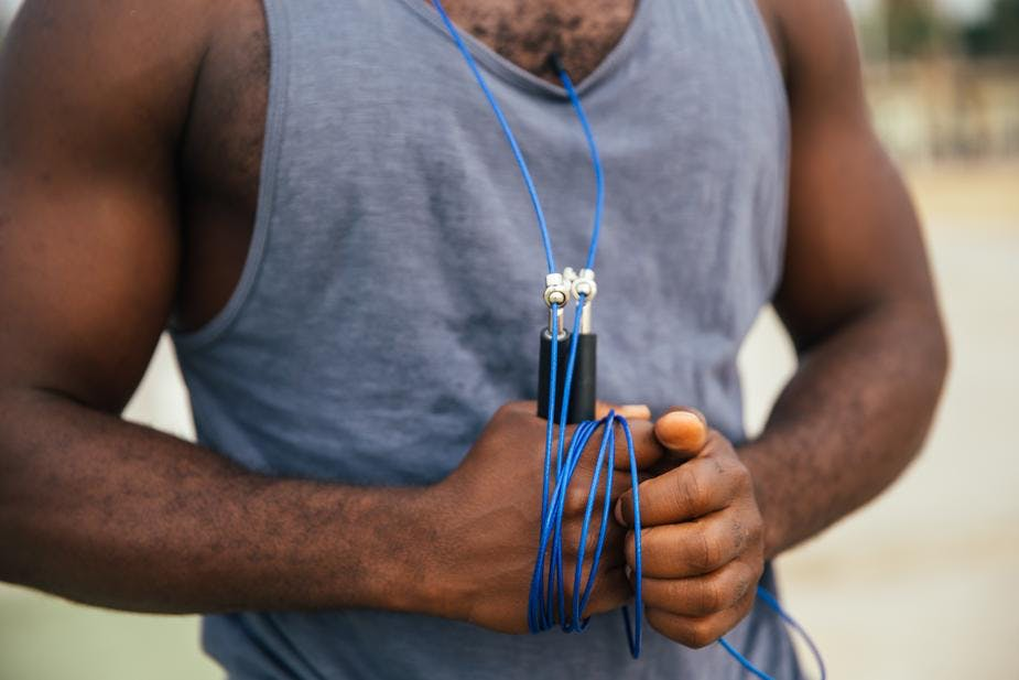 man holding skipping rope