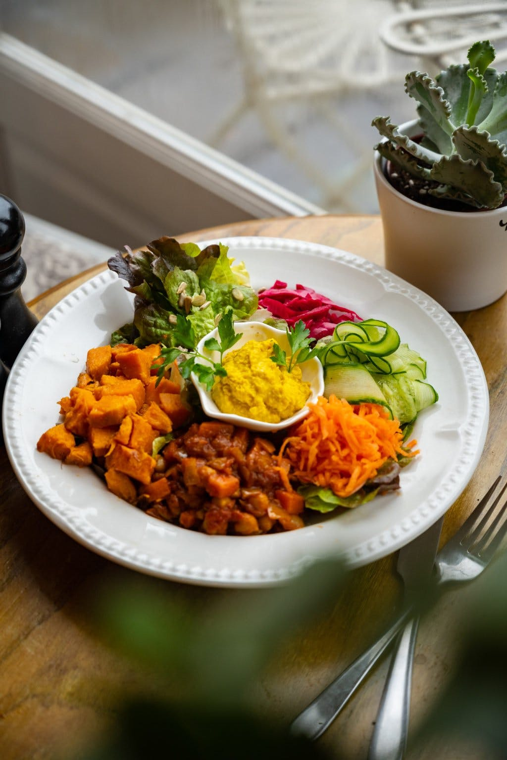 Plate of brightly coloured foods