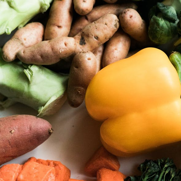 assortment of veg on white table