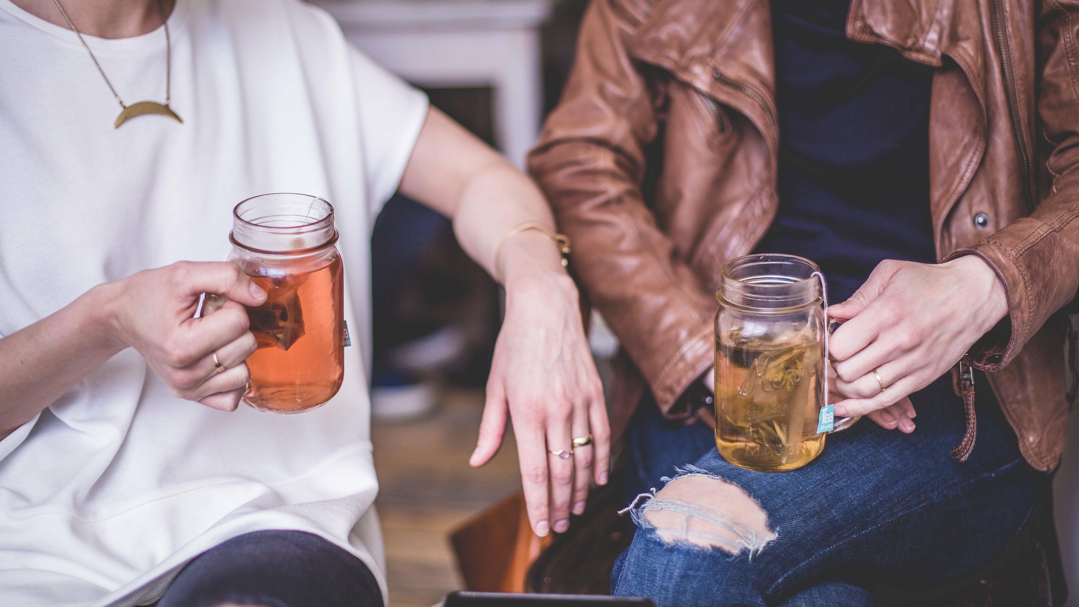 two people drinking tea