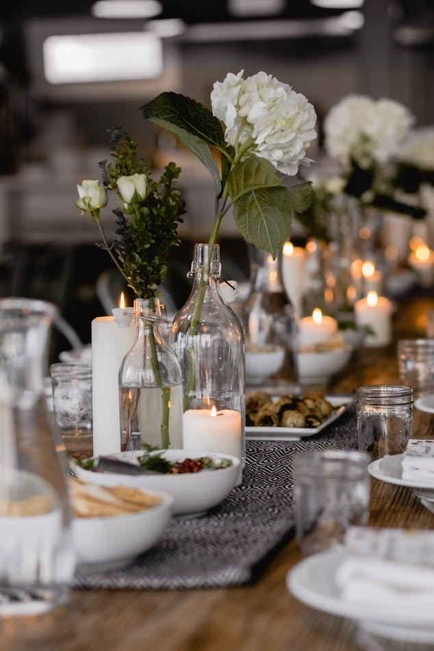 table settings with candles and flowers
