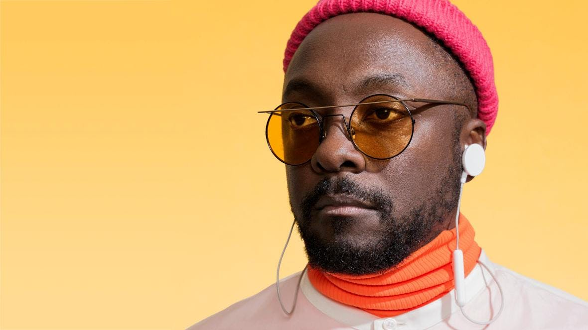 will.i.am yellow background and hat