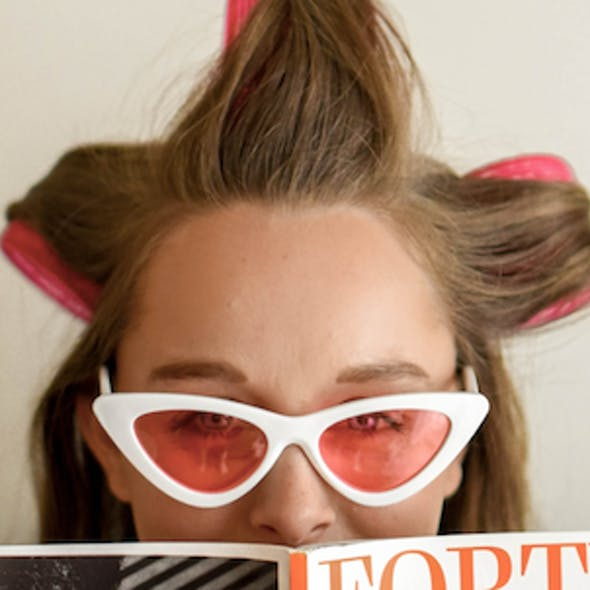 woman with hair in curlers
