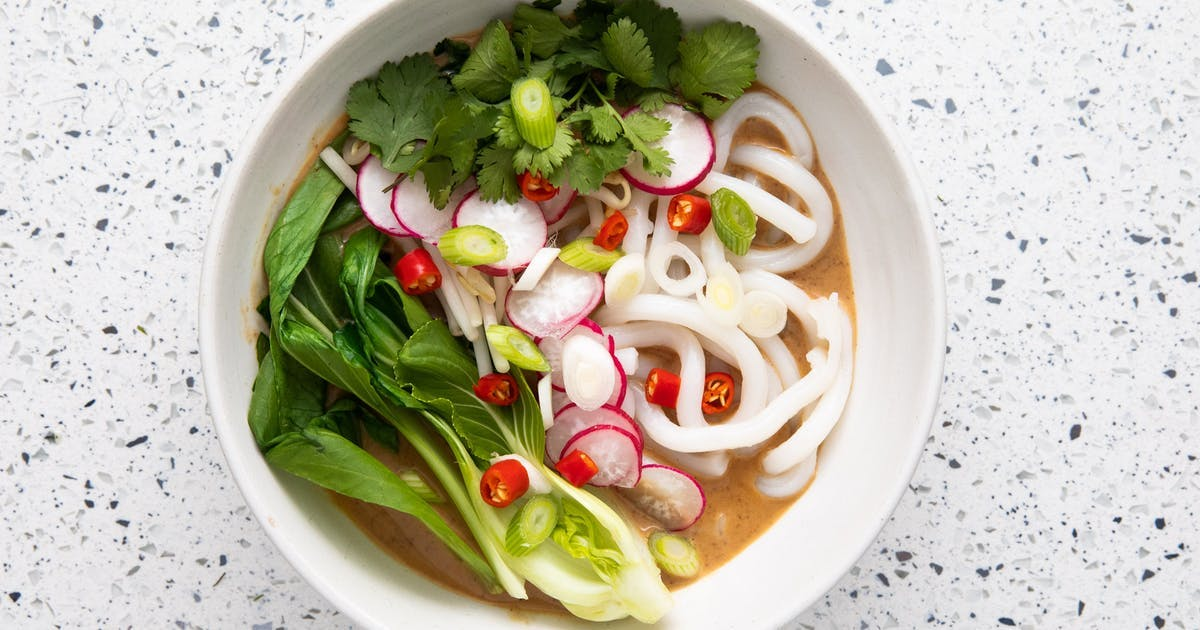 thai peanut ramen soup in bowl