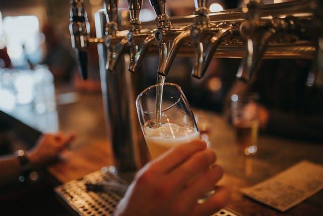 pulling a pint at the bar