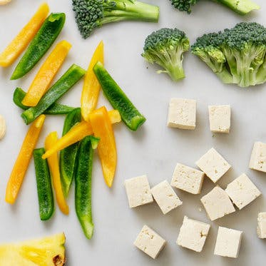 tofu, peppers, and broccoli on table