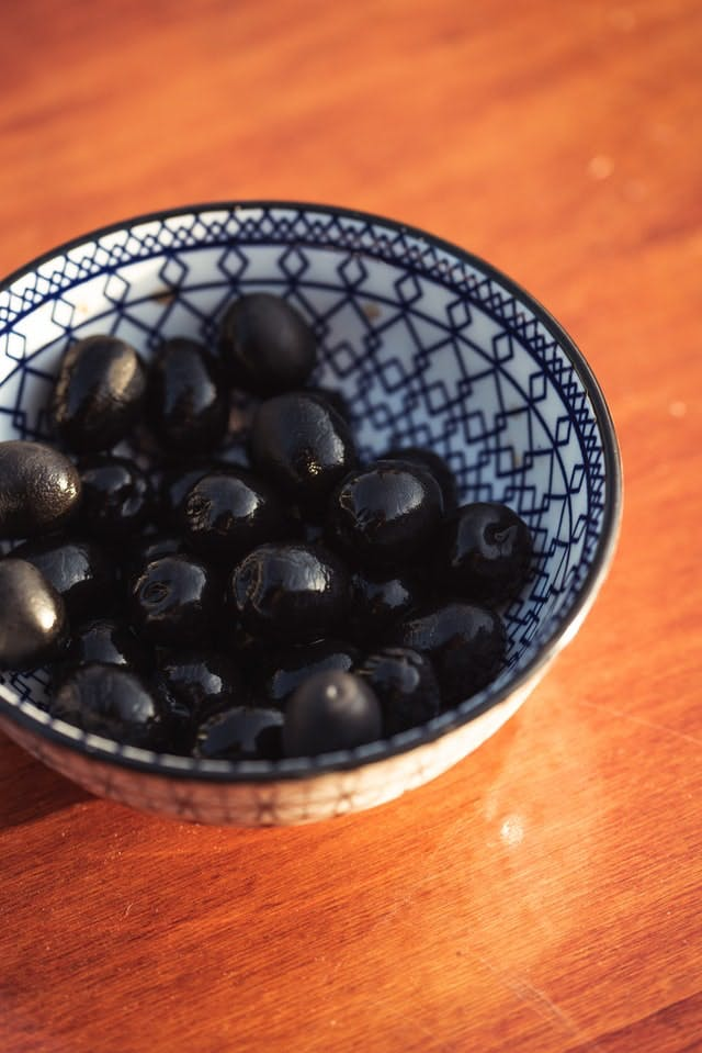 bowl of olives on wooden table