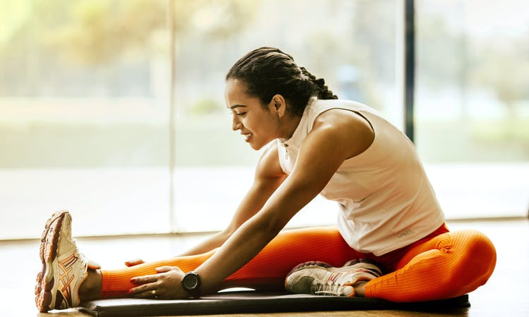 woman stretching right leg