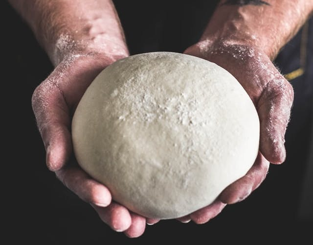 ball of dough in hands